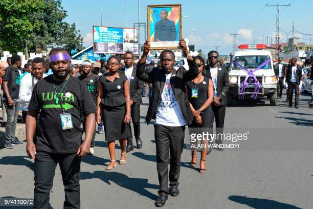 Activists of civil society movement Struggle for Change take part in the funeral procession for late Congolese prodemocracy activist Luc Nkulula in...