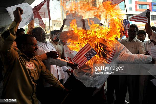 Activists of Communist Party of India burn an effigy representing the United States during a demonstration against the international coalition's...