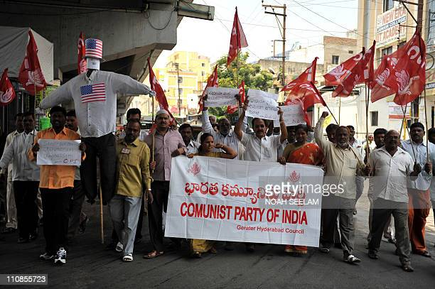 Activists of Communist Party of India hold up an effigy representing the United States during a demonstration against the international coalition's...