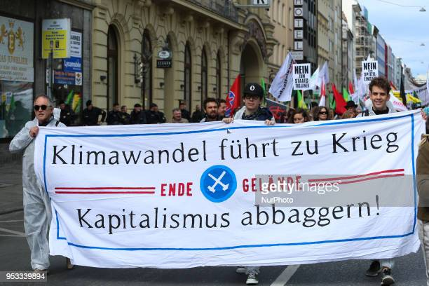 Activists of Ende Gelaende with a banner against Capitalism climate change and war Several thousands followed the invitation of the trade unions such...