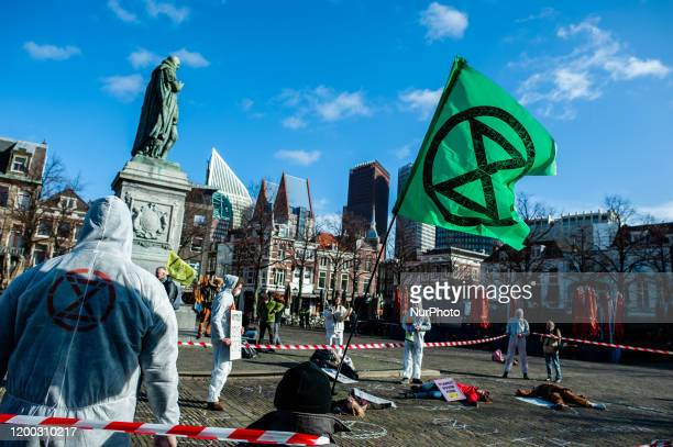 Activists of Extinction Rebellion movement take part in a demonstration to stop the CETA agreement in The Hague Netherlands on February 12 2020