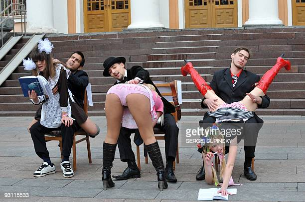 Activists of FEMEN a Ukrainian women movement defending women's conditions in the society perform during their protest action on November 16 2009 in...