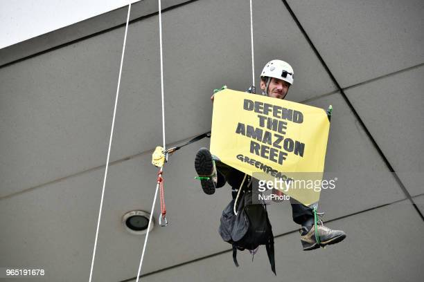 Activists of Greenpeace and Action Non ViolenteCOP21 stage a protest against oil exploitation in the Amazon during a general assembly of French oil...