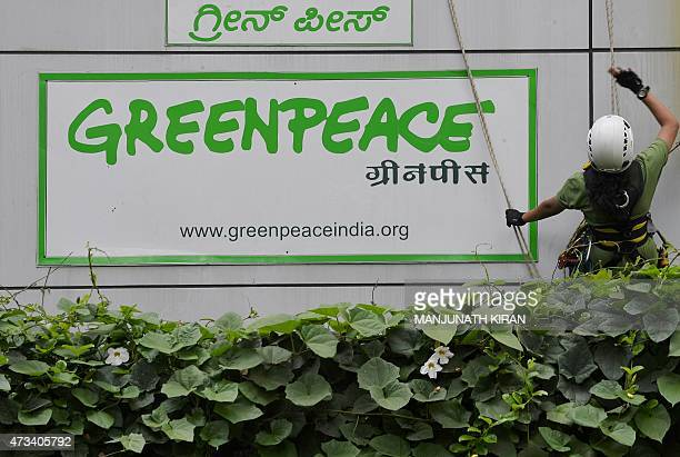 Activists of GreenPeace rappell down their office building where they are head quartered to unfurl banners 'democracy' and 'freespeech' in Bangalore...