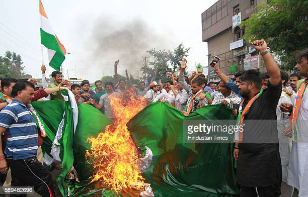 Activists of Hindu Shiv Sena burn a 40 foot long Pakistan flag as they were protesting against the crude bomb explosion near a Tata Sumo carrying...