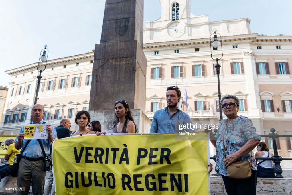 """Activists of human rights organisation Amnesty International hold a flag showing the slogan """"Truth for Giulio Regeni"""" and a placard saying """"Free Amal Fathy"""" during a demonstration in front of Palazzo Montecitorio, the Italian Parliament, to call for the release of Amal Fathy, Egyptian activist and wife of Mohamed Lotfy, director of the Egyptian Commission for Rights and Freedoms (ECRF) and Regenis family lawyer in Egypt, in Rome, Italy, on September 12, 2018. On May 9, 2018, Amal Fathy posted a video on her Facebook page denouncing sexual harassment in Egypt and criticising the governments failure to protect women; Egyptian police forces arrested Fathy on May 11, 2018, with the accusations of publishing a video calling for the overthrow of the regime, spreading false news that harms national security, and misuse of the internet. Giulio Regeni was an Italian Cambridge University graduate who was abducted and tortured to death in Egypt in 2016, sparking global outrage and a diplomatic crisis between Italian and Egyptian governments. SPATARI"""