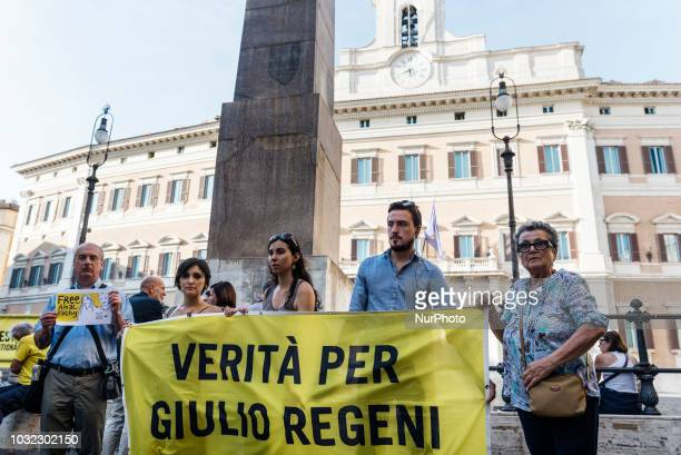 Activists of human rights organisation Amnesty International hold a flag showing the slogan quotTruth for Giulio Regeniquot and a placard saying...