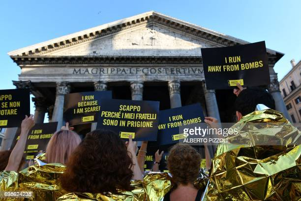 Activists of human rights organization Amnesty International gather in front of the Pantheon during a flashmob on World Refugee Day in central Rome...