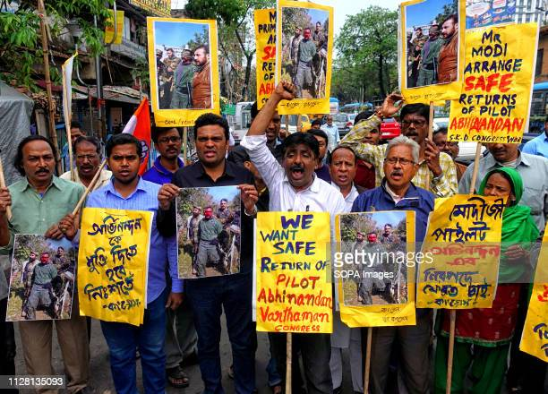 Activists of Indian National Congress are seen shouting slogans while holding placards during the protest against Pakistan and demand for a safe...