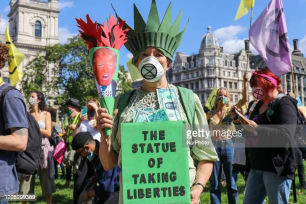 Activists of international climate action group Extinction Rebellion march from Trafalgar Square to Parliament Square on the first of a planned 10...