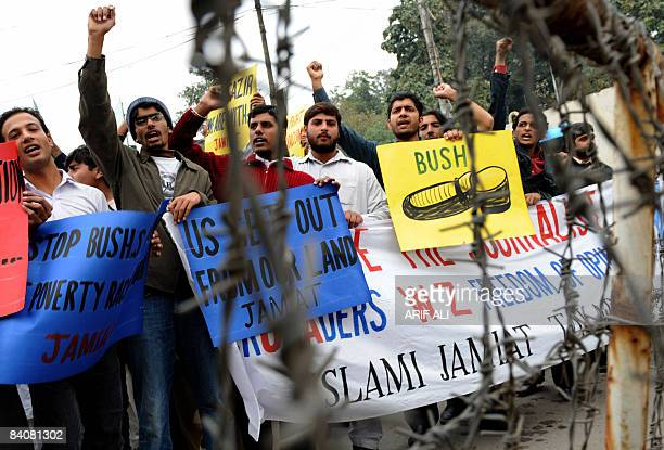 Activists of Islami Jamiat Talaba a student wing of Pakistan's main fundamentalist Islamic party of JamaatiIslami hold placards during a protest in...