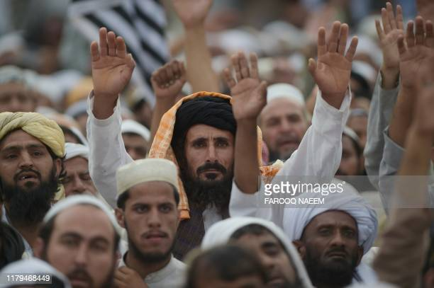 Activists of Islamic political party Jamiat UlemaeIslam chant slogans during an antigovernment Azadi March in Islamabad on November 2 2019 Tens of...
