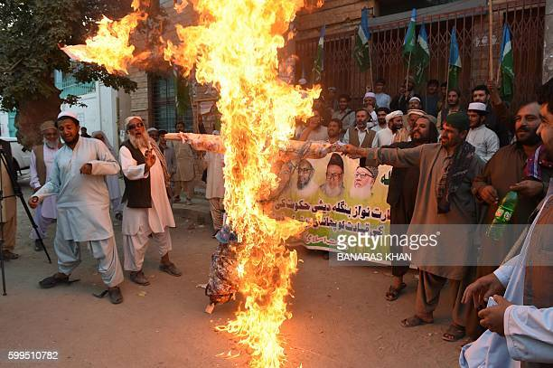 Activists of JamaateIslami Pakistan burn an effigy of Bangladesh Prime Minister Sheikh Hasina Wajid at a protest in Quetta on September 5 after the...