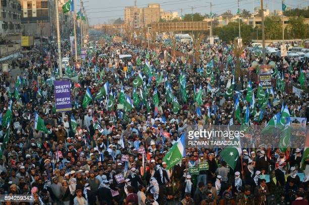TOPSHOT Activists of JamaateIslami Pakistan gather during an antiUS and antiIsrael protest rally in Karachi on December 17 following US President...