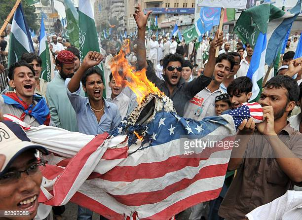 Activists of JamaateIslami the main Islamic religious party of Pakistan torch an effigy of US President George W Bush during a protest in Karachi on...