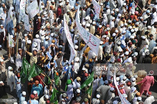 Activists of Jamaat-e-Sunnah and supporters of convicted killer Malik Mumtaz Hussain Qadri, march during a protest in Lahore on October 3, 2011. A...