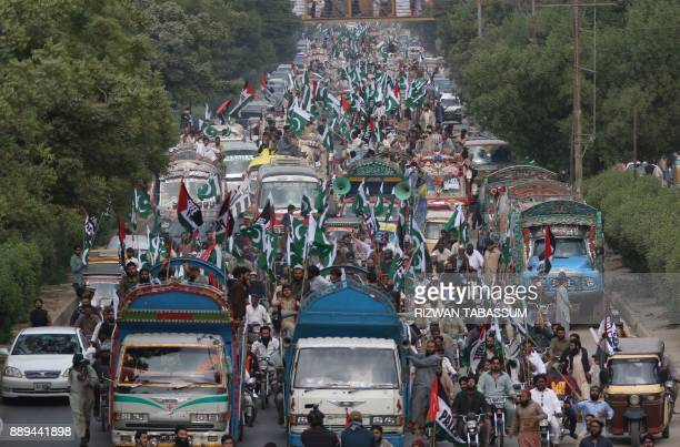 Activists of JamaatudDawa march during an antiUS and antiIsraeli protest in Karachi on December 10 following US President Donald Trump's decision to...