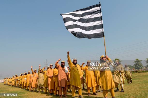 Activists of Jamiat Ulemae Islam Fazal party raise hands as they prepare an 'Azadi' march in Peshawar on October 13 2019 JUIF chief Maulana...