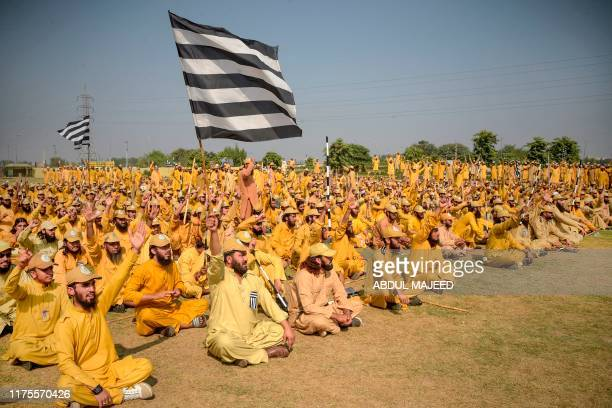 Activists of Jamiat Ulemae Islam Fazal party sit as they prepare an 'Azadi' march in Peshawar on October 13 2019 JUIF chief Maulana FazalurRehman had...