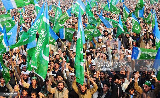 Activists of JammateIslami Pakistan wave party flags during a rally in Peshawar on December 18 2011 JI leaders criticised the Pakistani government on...