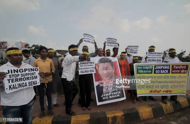 Activists of Kalinga Sena group holds placards against Chinese President Xi Jinping and shouted anti China slogans with burnt the President of...