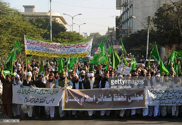 Activists of Majlisa Tahafuz Shayr Islam Pakistan demonstrate in Karachi on January 16 in support of Malik Mumtaz Hussain Qadri Confessed killer...