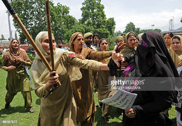 Activists of Muslim Khawateen Markaz scuffle with policewomen as they shout antiIndian and antigovernment slogans during a protest in Srinagar on...