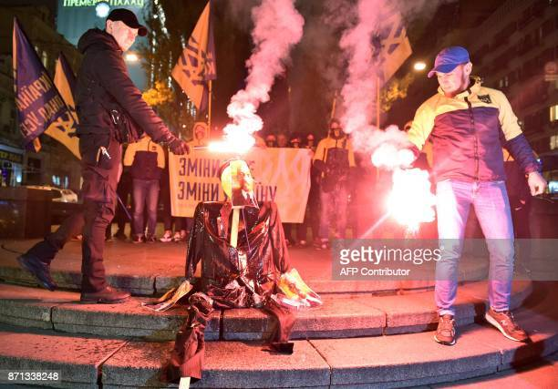 Activists of nationalist movement burn a rough effigy of revolutionary and Soviet Union founder Vladimir Lenin during their action in Kiev on...