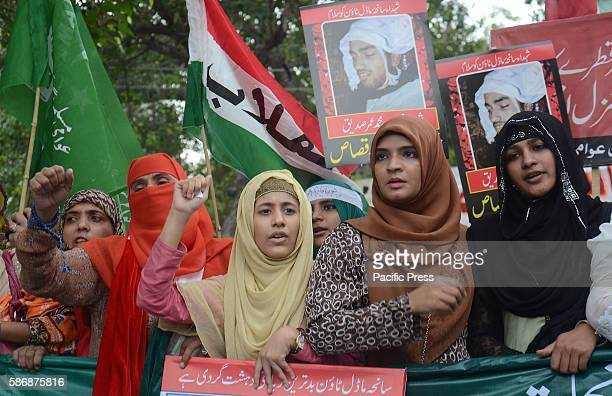 Activists of Pakistan Awami Tehreek organisation take part in antigovernment protests in Lahore to mark two years since Model Town Massacre still no...