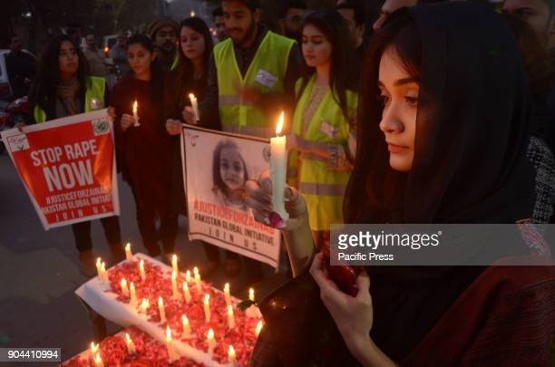 Activists of Pakistan Global Initiative and Civil Society members hold candlelight vigil outside Press Club in memory of 7 year old Zainab in Lahore...