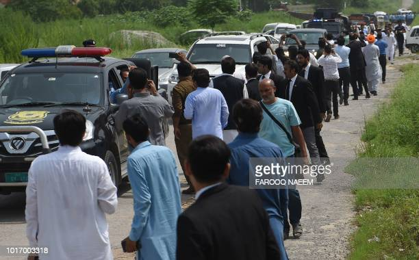 Activists of Pakistan Muslim League Nawaz party gather around the convey of the former Pakistani Prime Minister Nawaz Sharif during his arrival at...
