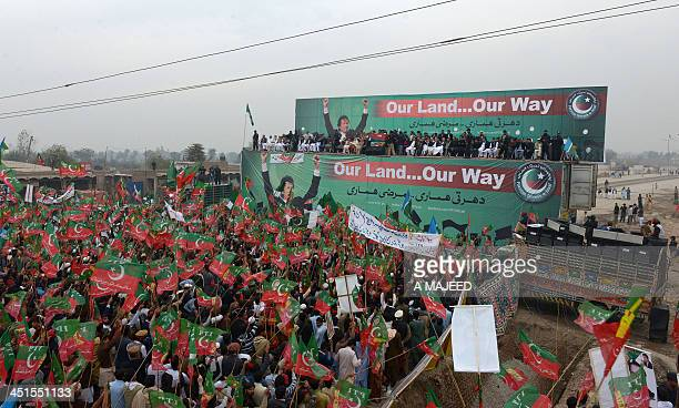 Activists of Pakistan TehreekeInsaaf gather during a protest rally in Peshawar on November 23 2013 Thousands of Pakistani activists from rightwing...