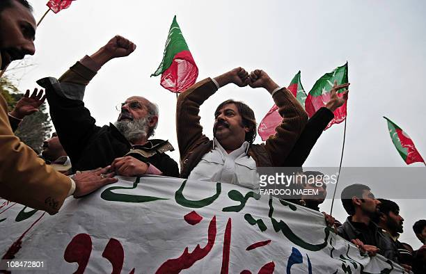 Activists of Pakistan Tehreek-e-Insaf march towards the US consulate during a protest rally in Islamabad on January 28 against a US consulate...