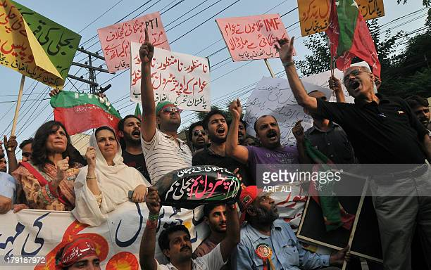 Activists of Pakistan Tehreek-e-Insaf protest against the oil price hike at a rally in Lahore on September 1, 2013. The Pakistan government raised...
