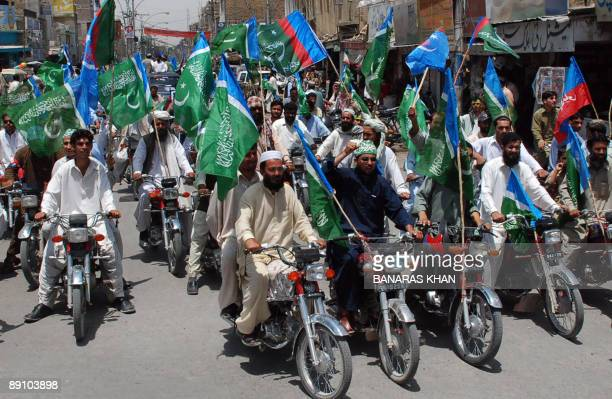 Activists of Pakistani JamaateIslami party march during anantiUS rally in Quetta on July 19 2009 against the military operation in tribal areas EU...