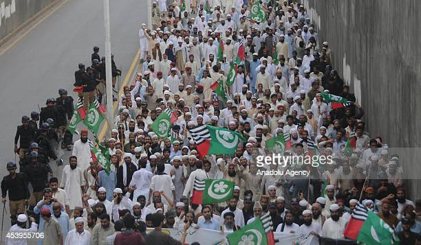Activists of Pakistani religious party Ahle Sunnat Wal Jamaat march during an anti Imran Khan and TahirulQadri protest rally on August 22 in...