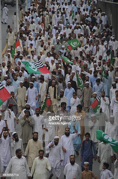 Activists of Pakistani religious party Ahle Sunnat Wal Jamaat march as they take part in an anti Imran Khan and TahirulQadri protest rally on August...