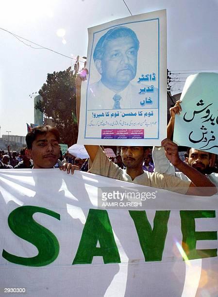 Activists of Pakistan's main fundamentalist party JamaateIslami display portraits of Pakistan's disgraced nuclear scientist doctor Abdul Qadeer Khan...