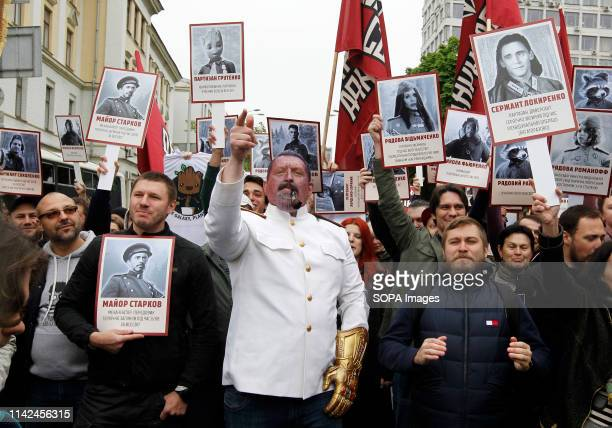 Activists of political movement ''Democratic ax' 'seen holding portraits of Marvel comics characters during the victory Day Immortal Regiment march...