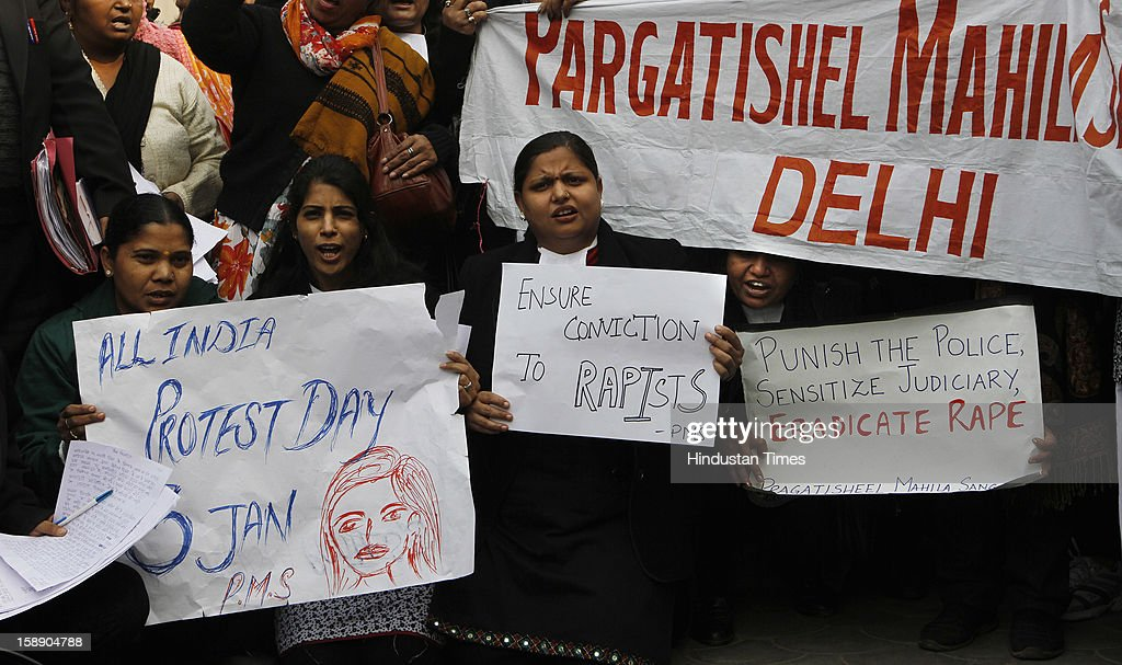 Activists of Pragatishil Mahila Sangathan Delhi and women lawyers protesting outside newly inaugurated fast track court at Saket District court where police were preparing to file rape and murder charges against a group of men accused of sexually assaulting a 23-year-old university student for hours on a moving bus on January 3, 2013 in New Delhi, India.