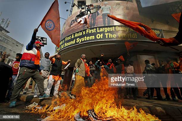 Activists of rightwing organizations Bajrang Dal and Hindu Sena burn the posters of Aamir Khanstarrer film PK outside Delite Cinema Theater on...