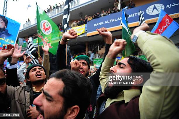 Activists of ShababeIslami Pakistan and Tehreek NamooseRisalat shout slogans during a protest rally in Rawalpindi on January 14 in support of Malik...