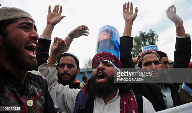 Activists of Shabab-e-Islami Pakistan shout slogans outside the Adiyala prison in Rawalpindi on February 14 in the support of detained self-confessed...