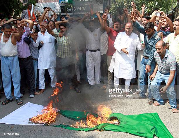Activists of Shiv Sena Dogra Front burn Pakistan flag during a protest against Uri terrorist attack on rear office of the infantry battalion of the...