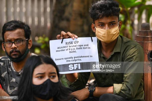 Activists of Student Federation of India hold placards during a protest against the alleged rape and murder of a nine-year-old girl, in New Delhi on...