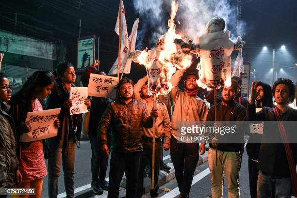 TOPSHOT Activists of Students' Federation of India burn the effigies of India's Prime Minister and Chief Minister of Assam in Guwahati on January 8...