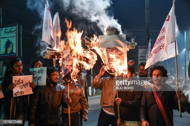Activists of Students' Federation of India burn the effigies of India's Prime Minister and Chief Minister of Assam in Guwahati on January 8 2019...