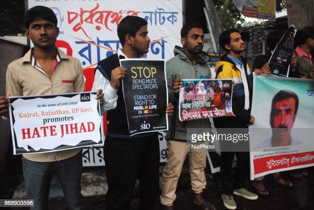 Activists of Students Islamic Organisation holds placards during the protest against the killing of a Muslim Labour Afrazul Khan from Malda West...