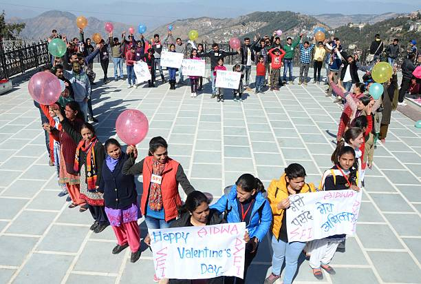 Activists of students unions DYFI SFI AIDWA celebrating Valentine day at Ridge on February 14 2015 in Shimla India Valentine`s Day also known as...