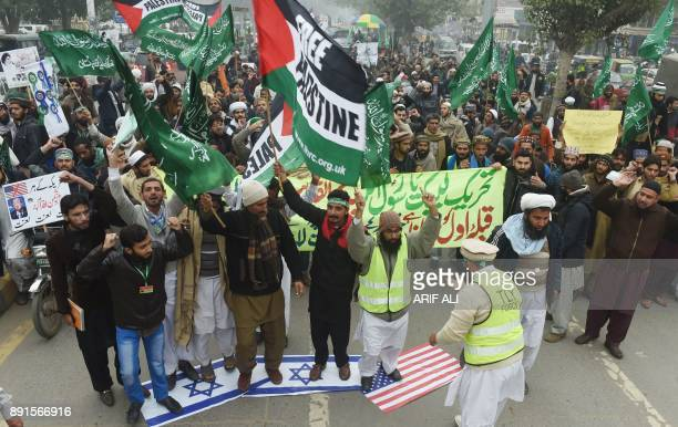 Activists of Tehreek e Labaik Pakistan protest during an antiUS and Israel rally in Lahore on December 13 following US President Donald Trump's...